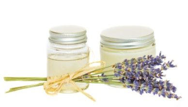 jars with cream and  dry lavender  isolated on white background