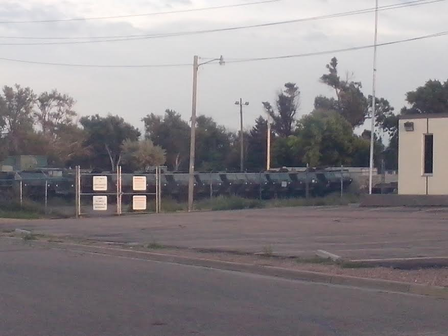 lajunta-old-walmart-housing-militayry-vehicles