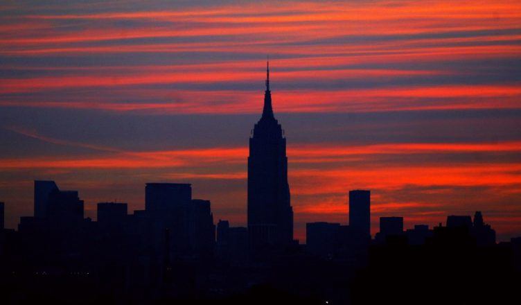 UNITED STATES - AUGUST 15:  Manhattan skyline is dark as the sun comes up on the morning after a massive power failure caused the largest power outage in the nation's history, affecting 50 million people in parts of seven states and Canada.  (Photo by Mike Albans/NY Daily News Archive via Getty Images)